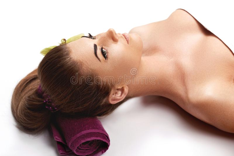 Face Massage. Close-up of a Young Woman Getting Spa Treatment. Spa skin and body care. Facial beauty treatment stock images