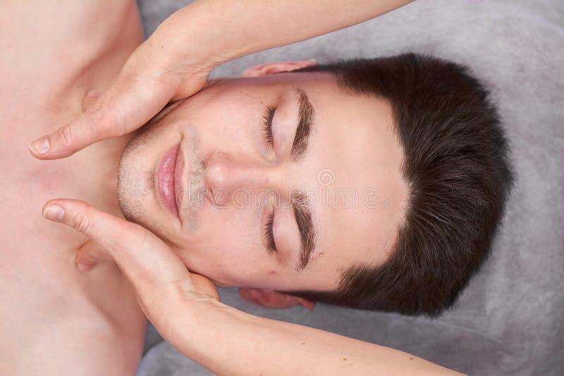 Face massage, handsome man. stock image
