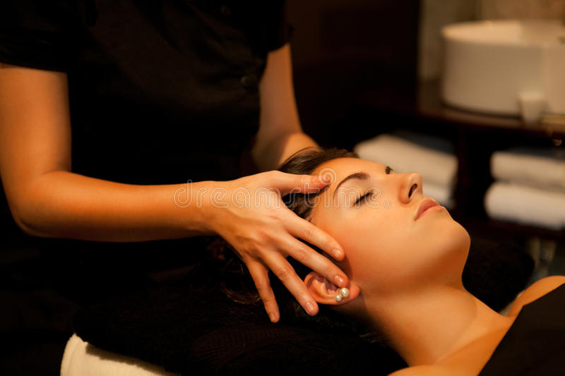 Face massage. Spa Treatment. Woman receiving a face massage during spa treatment royalty free stock image