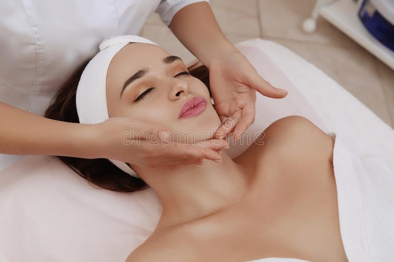 Face Massage of a Young Woman Getting Spa Treatment. stock image