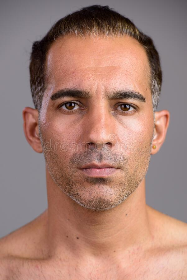Face of mature handsome Persian man shirtless stock photo