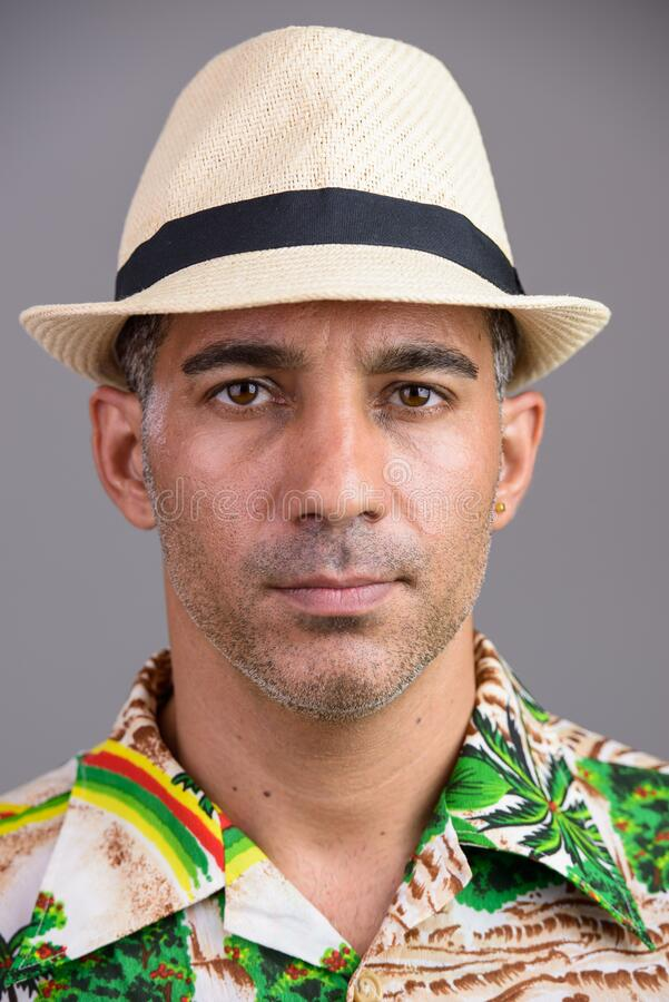 Face of mature handsome Persian tourist man ready for vacation royalty free stock images