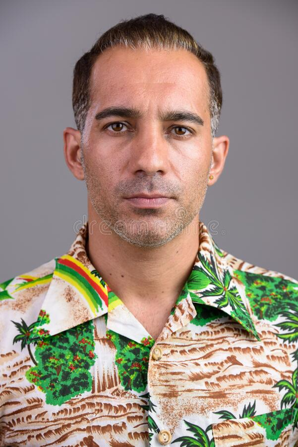 Face of mature handsome Persian tourist man royalty free stock photo
