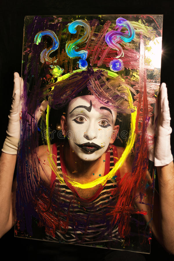 Face of Mime behind glass royalty free stock photo