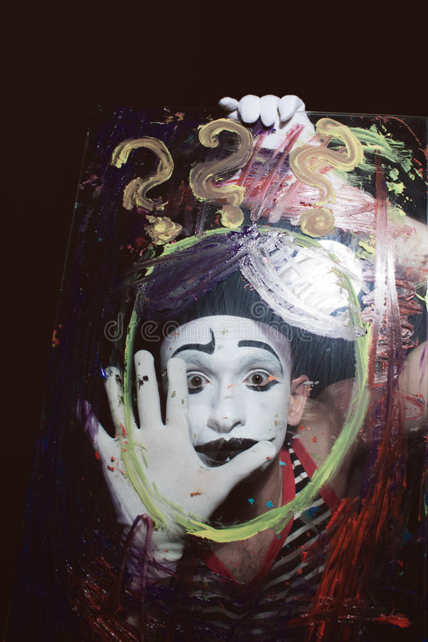 Face of Mime behind glass stock photos