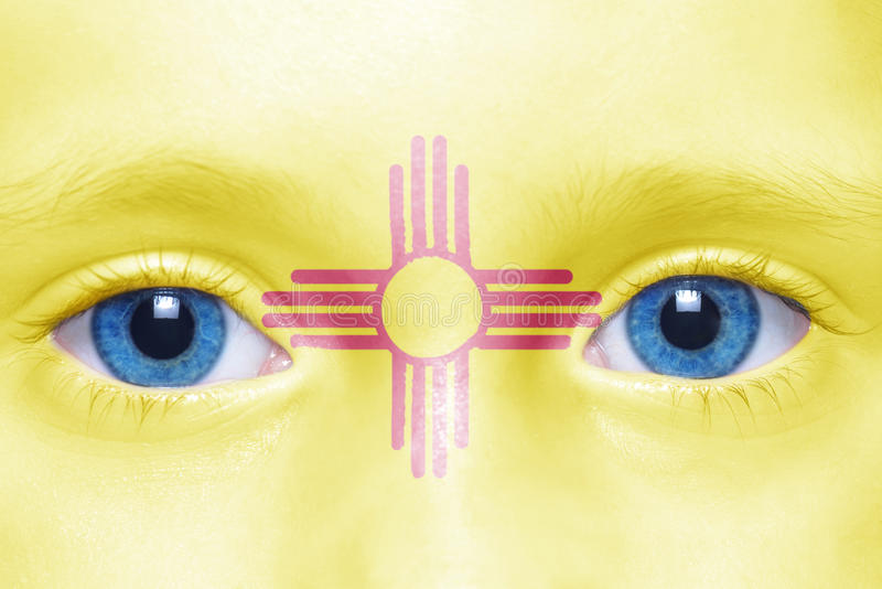 Face with new mexico state flag. Human`s face with new mexico state flag royalty free stock photo