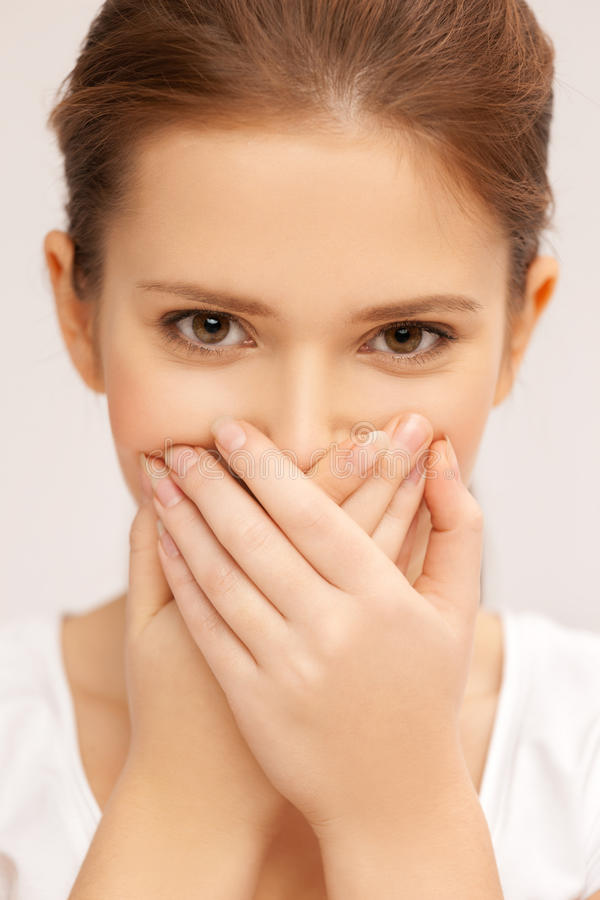 Free Face Of Beautiful Teenage Girl Covering Her Mouth Royalty Free Stock Photo - 34392965