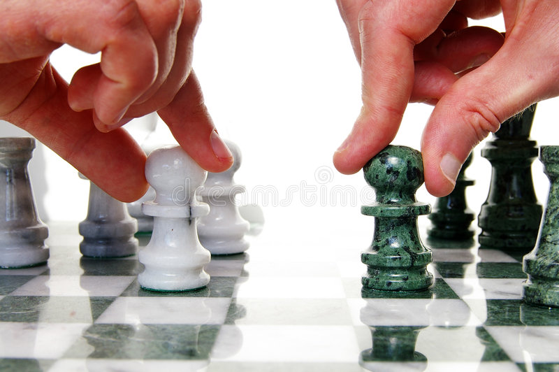 Face off. Two players facing off on the chess board royalty free stock photography