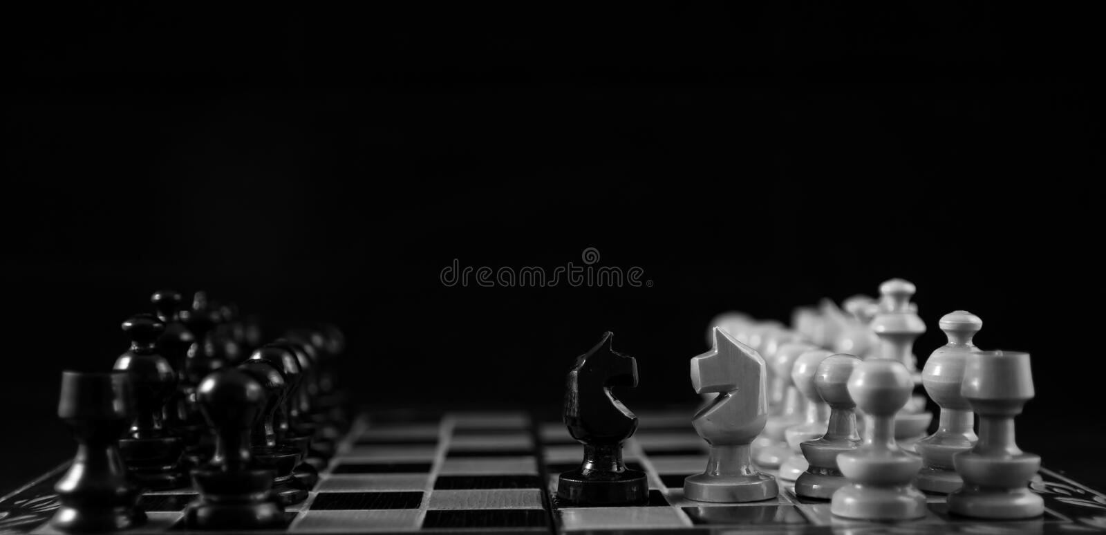 Face off. Chess players, the horses facing off stock images