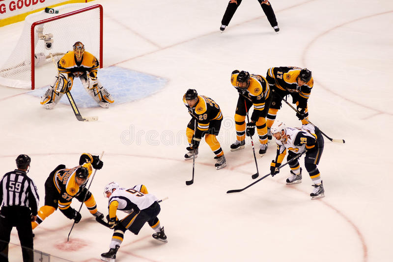 Face-off in the corner. Boston Bruins and Buffalo Sabres line up for a face-off deep in the Bruins Zone stock images