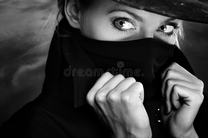 Face-off illegal person. Illegal person in hat with face covered by scarf royalty free stock images