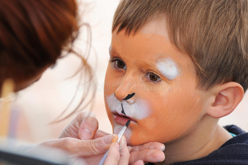 Face painting. Child face painting during a party stock images