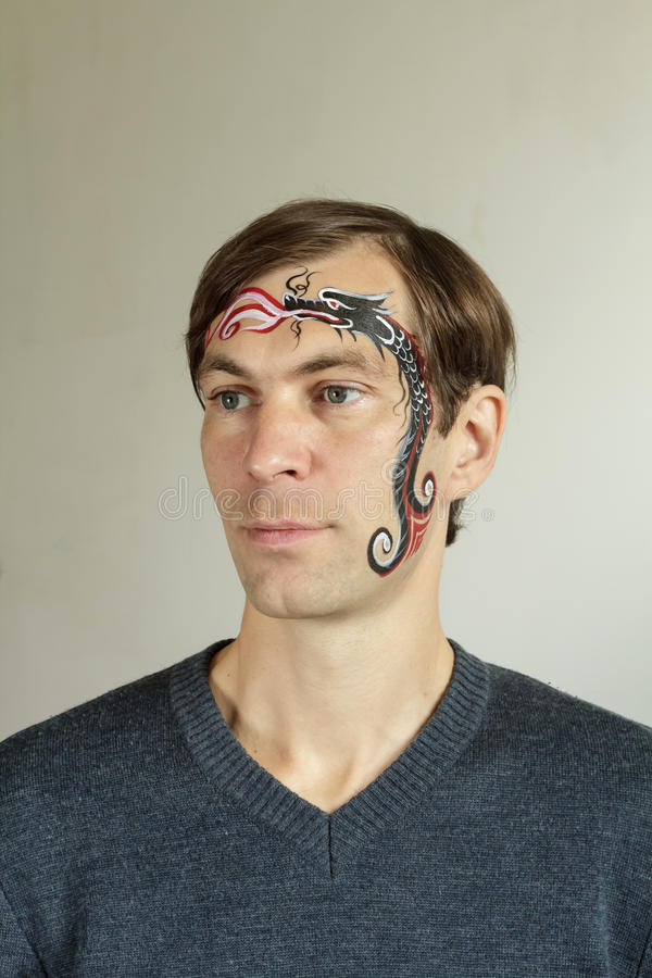 Face painting Chinese dragon stock image