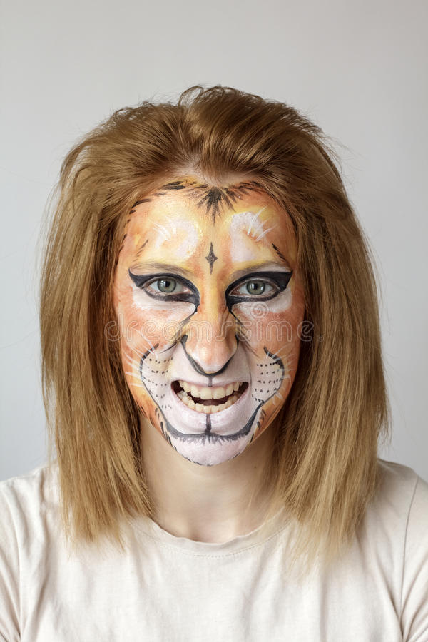 Face painting Lion stock images