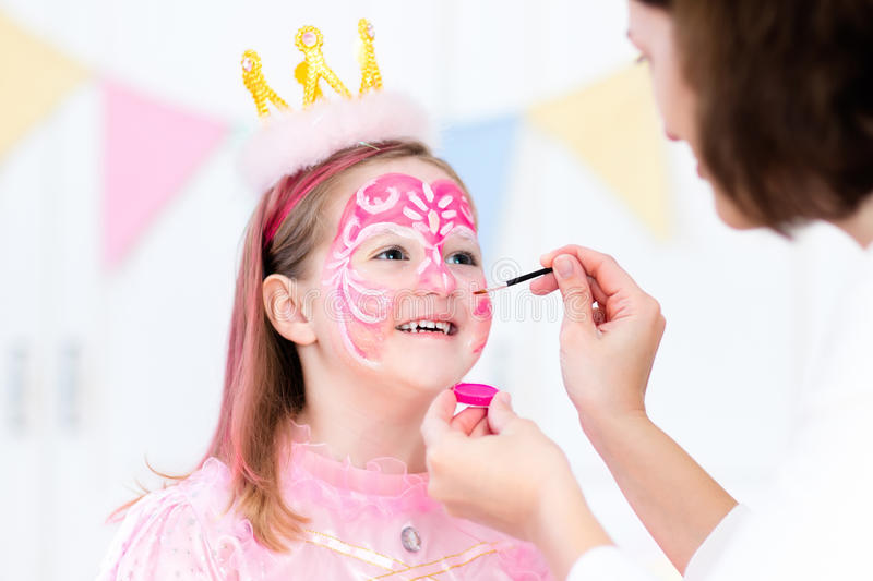 Face painting for little girl birthday party. Face painting for little girl. Princess and fairy theme birthday party with face paint artist and costume for stock image