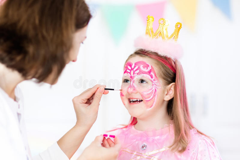 Face painting for little girl birthday party. Face painting for little girl. Princess and fairy theme birthday party with face paint artist and costume for royalty free stock images