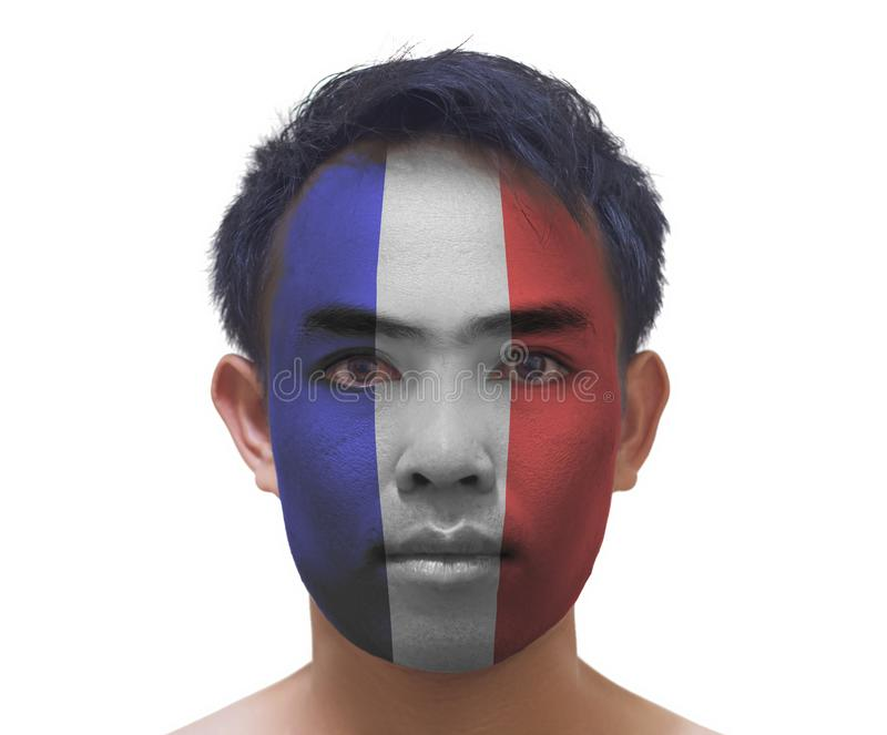 Face painting of serious asian young France football fan on whit stock images