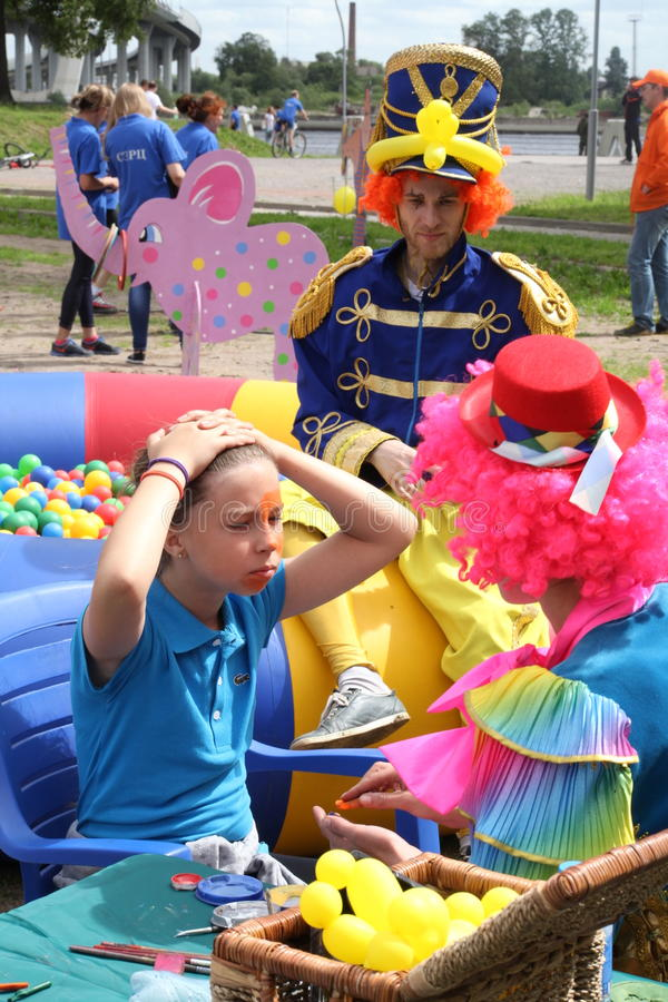 Face painting in street circus stock photo