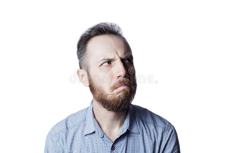Face of an pensive and insult male stock image