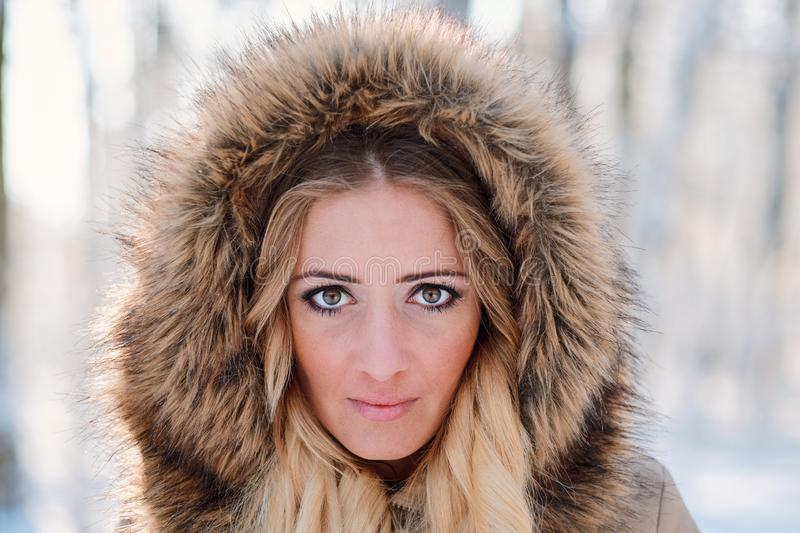 Face portrait of blonde woman with hood royalty free stock photography