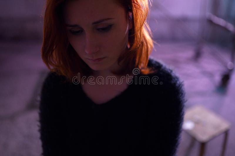 Face portrait close up of drug addiction redhead caucasian white young woman wearing black sweater, skirt and chocker royalty free stock photo