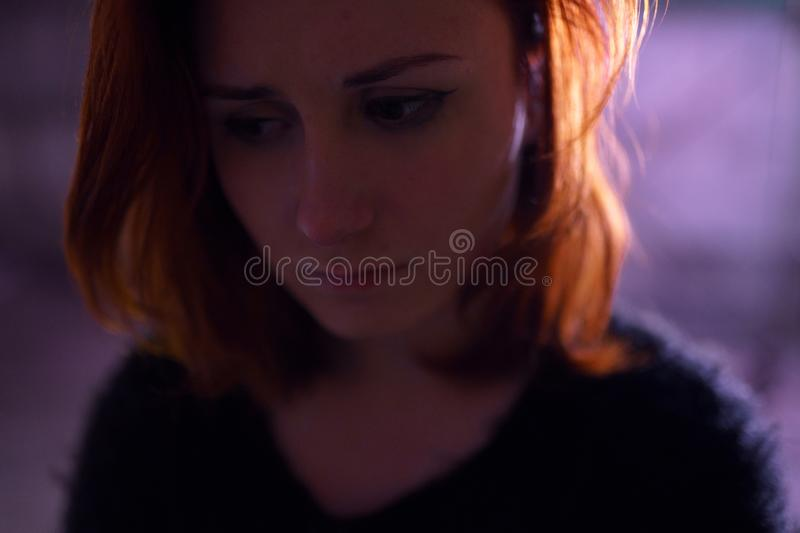 Face portrait close up of drug addiction redhead caucasian white young woman wearing black sweater, skirt and chocker royalty free stock photography