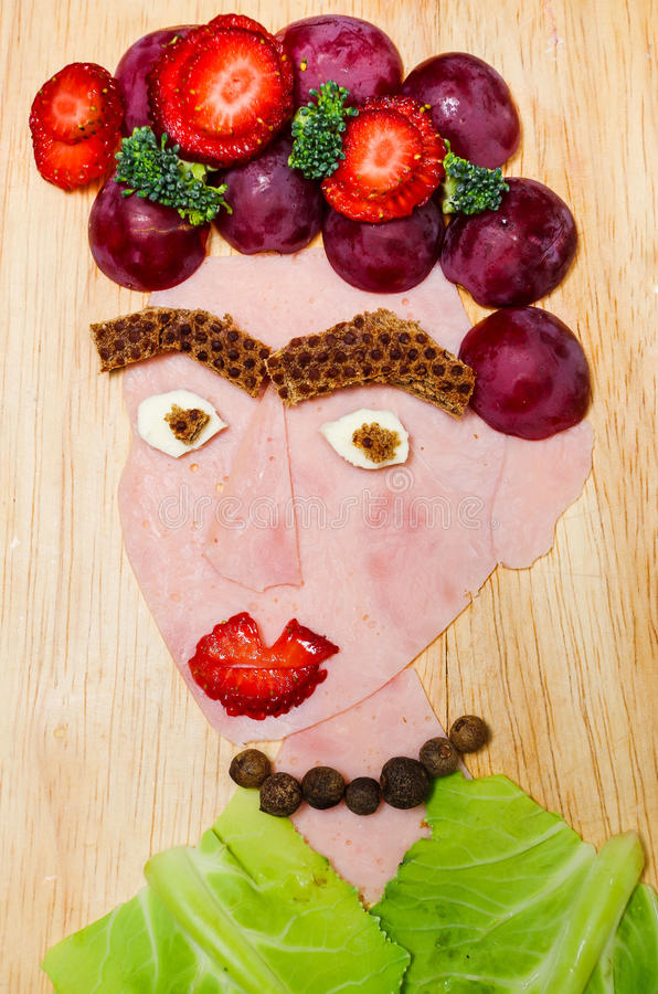 Face portrait made from various sliced grocery products, artistic food concept stock photo