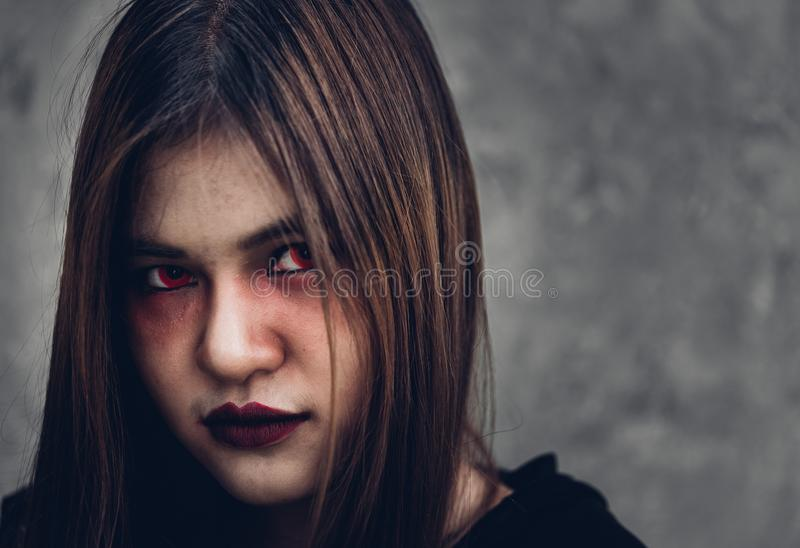 Face of portrait woman ghost. Have red eye halloween concept royalty free stock photo