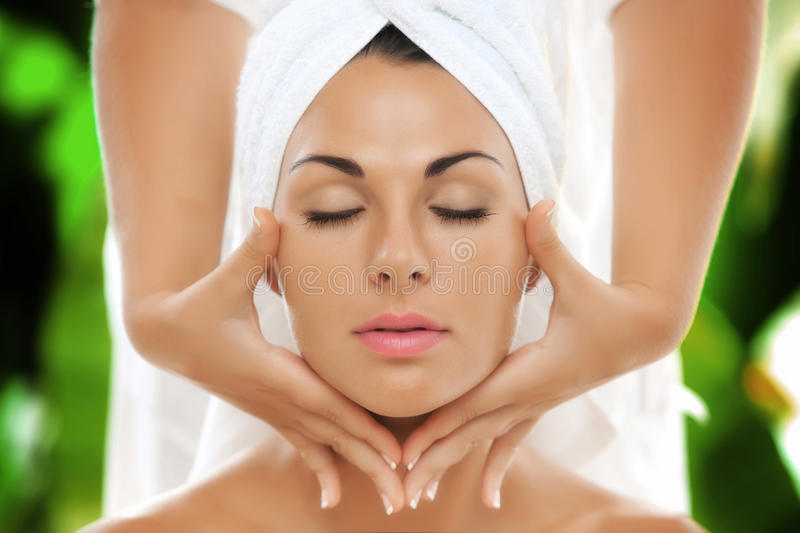 Face. Portrait of young beautiful woman in spa environment stock photos