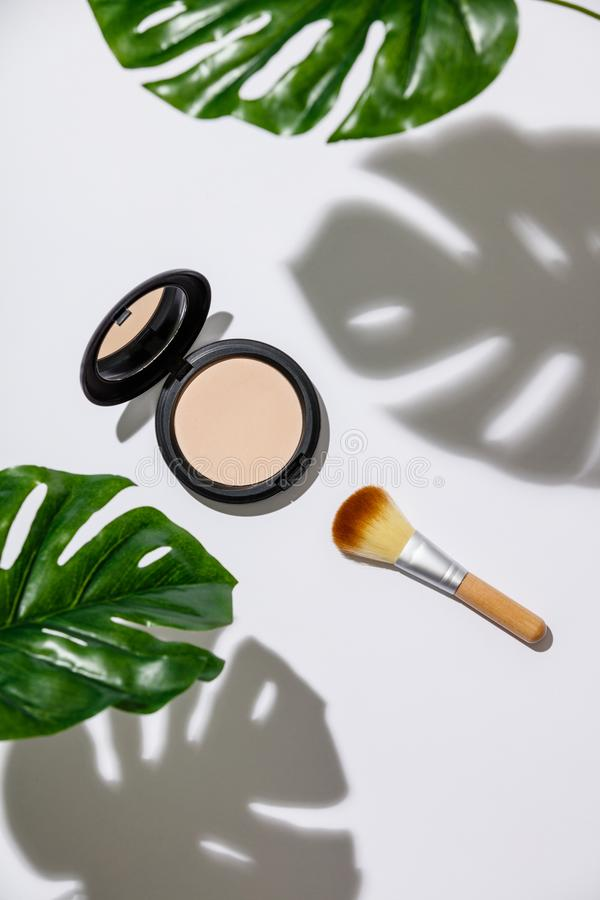 Face powder and brush for makeup royalty free stock photography
