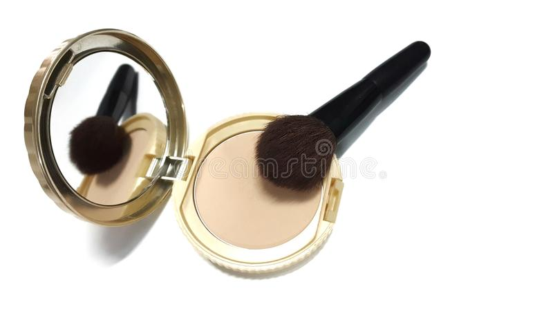 Face powder in gold powder case with a brush royalty free stock photography