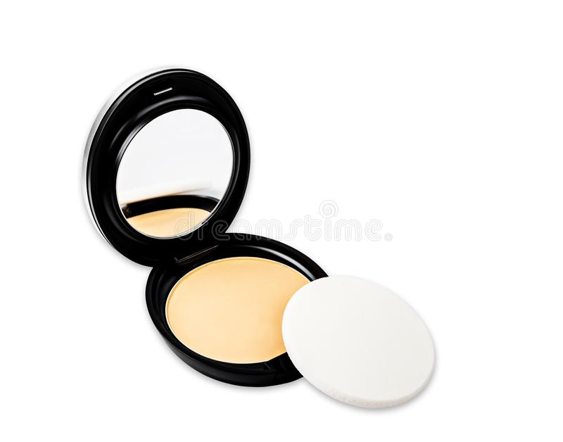Face powder for makeup in case and white sponge royalty free stock photography