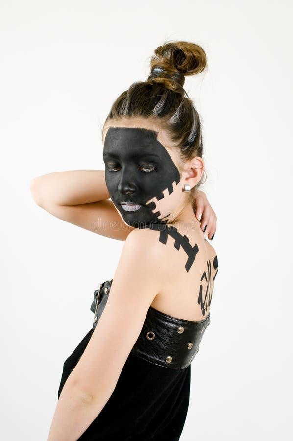 Face preta pintada da forma menina adolescente foto de stock