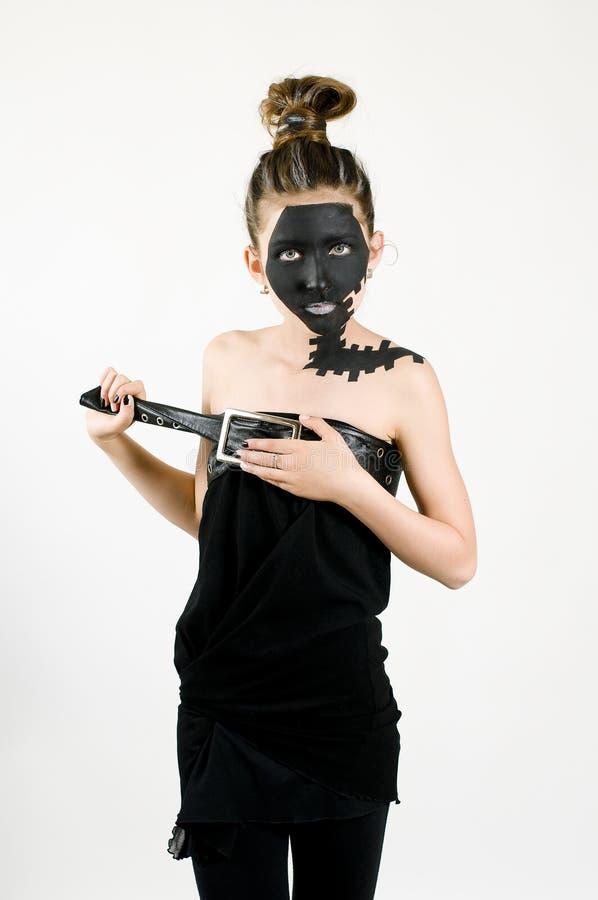 Face preta pintada da forma menina adolescente fotografia de stock