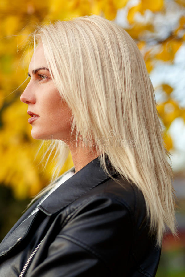Face in profile of beautiful caucasian blond woman outdoors stock images