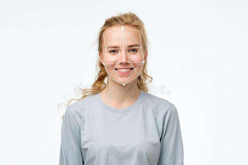Face recognition in modern technology concept. Portrait of happy blonde girl stock photos