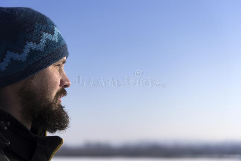 Face of Scandinavian bearded man in profile. Bearded looking into the distance. Close-up. Face of Scandinavian bearded man in profile. Bearded looking into the stock photo