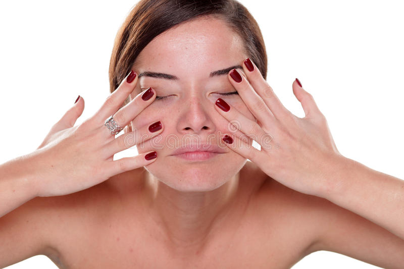 Face self-massage royalty free stock photography