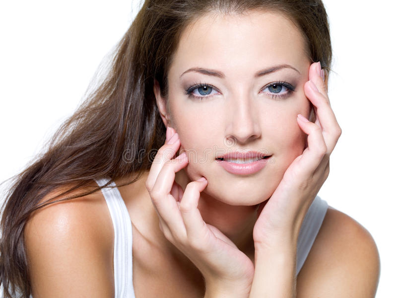Face of a beautiful young woman. With clean skin on a white background stock photos