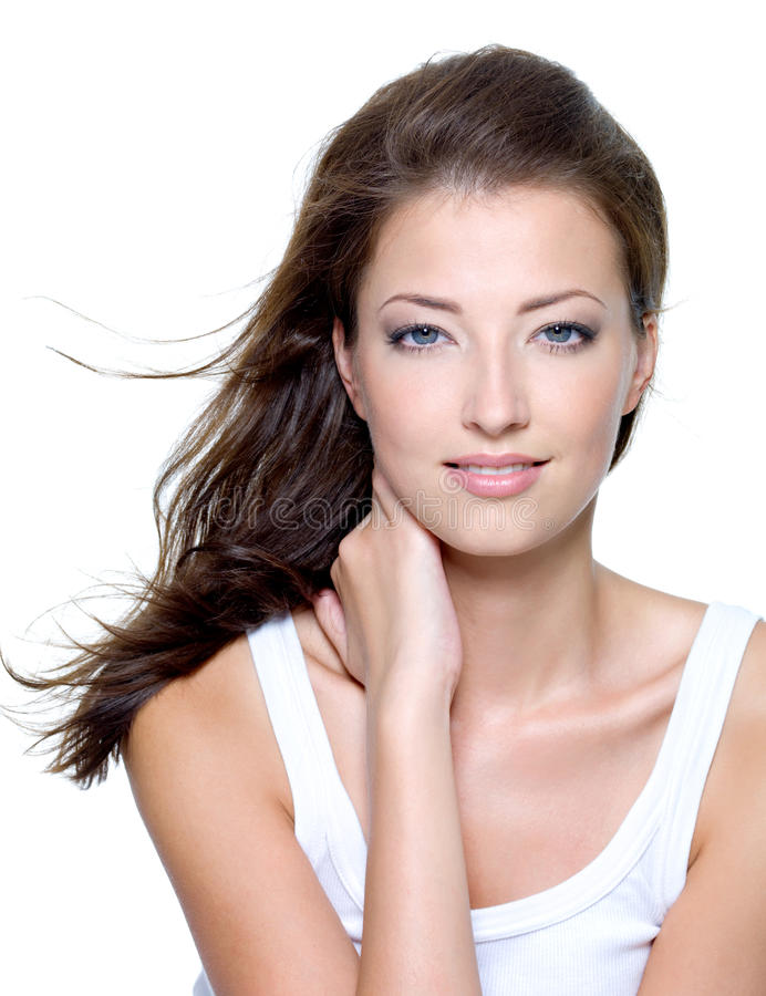 Face of a beautiful young woman. With clean skin on a white background stock images