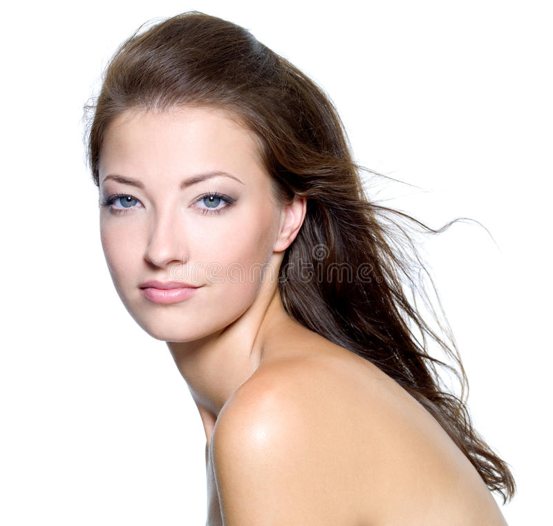 Face of a beautiful young woman. With clean skin on a white background royalty free stock photos