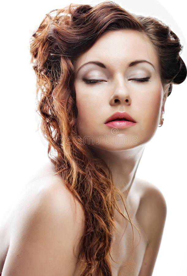 Face of a beautiful young woman with clean skin on a white royalty free stock images