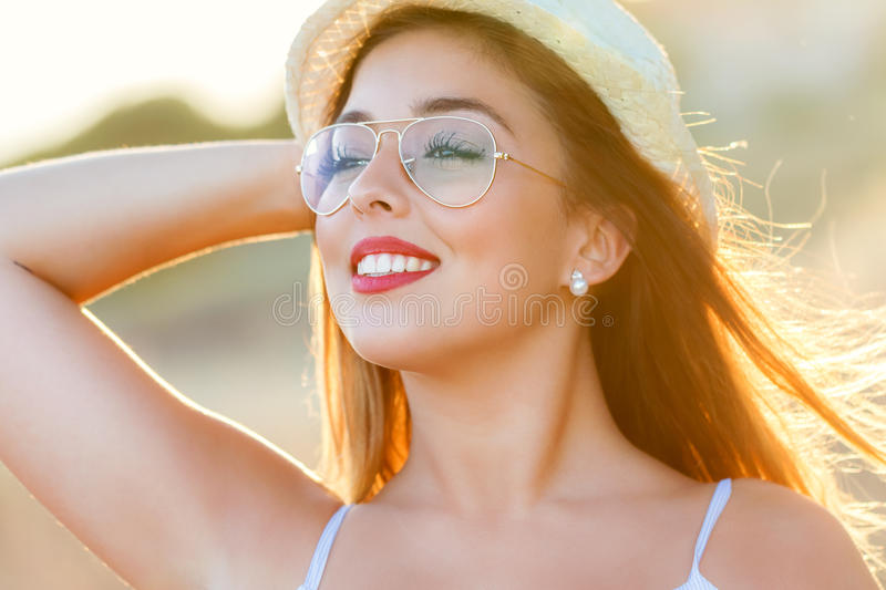 Face shot of teen girl at sunset. stock photography