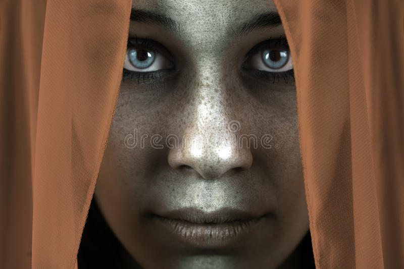 Face of shy freckled woman with beautiful big eyes stock photo