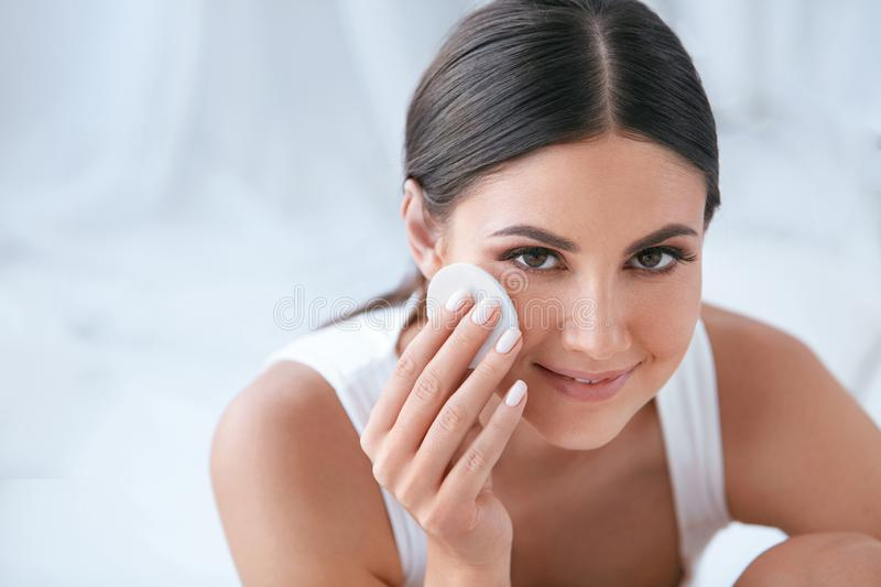 Face Skin Care. Beautiful Woman Removing Makeup With Cotton Pad stock photo