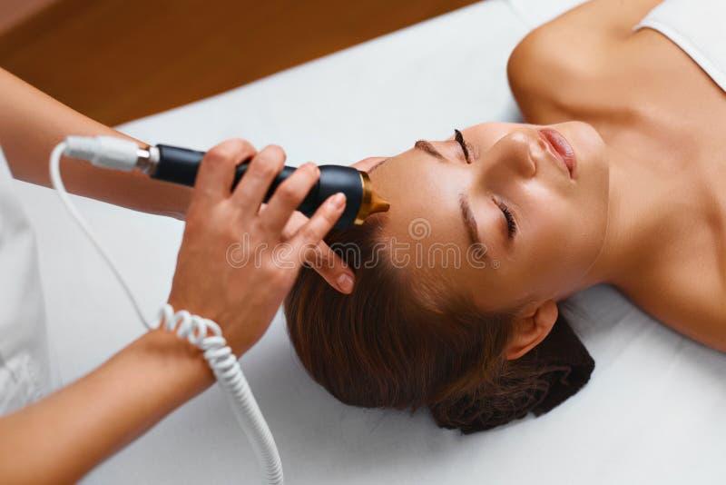 Face skin care treatment. Ultrasound cavitation procedures. royalty free stock photo