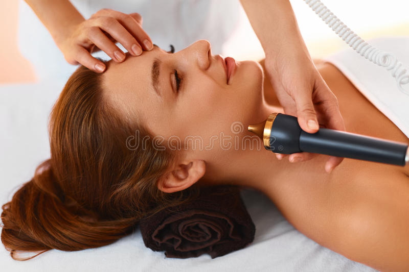 Face skin care. Ultrasound cavitation face treatment in medical stock photo