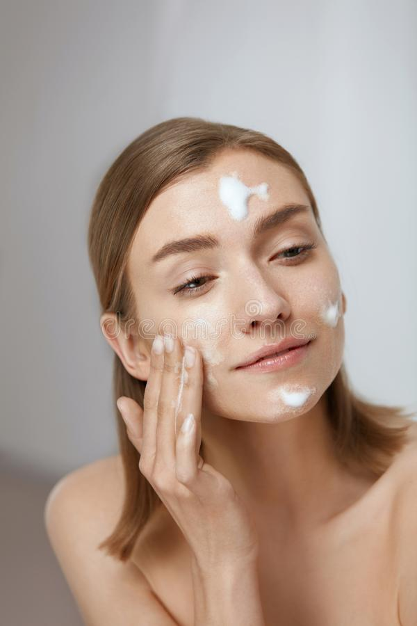 Free Face Skin Care. Woman Applying Facial Cleanser On Face Closeup Royalty Free Stock Photography - 157513947