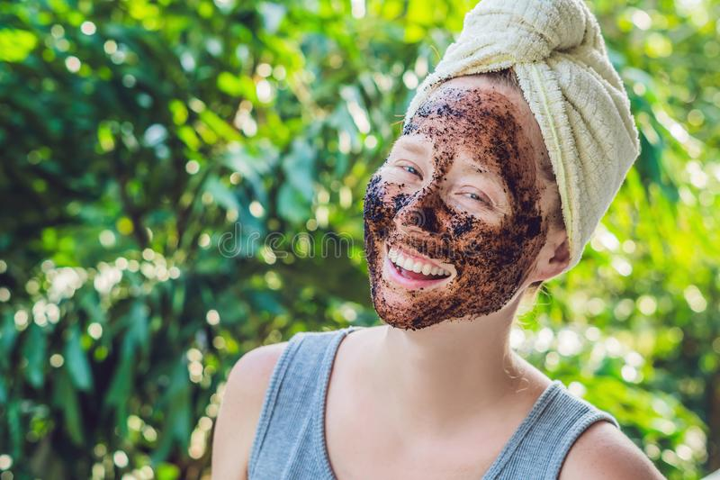Face Skin Scrub. Portrait Of Smiling Female Model Applying Natural Coffee Mask, Face Scrub On Facial Skin. Closeup Of Beautif. Face Skin Scrub. Portrait Of stock images