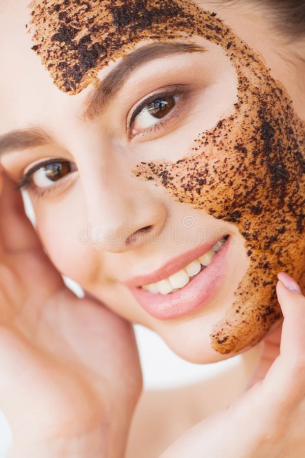 Face Skincare. Young Charming Girl Makes a Black Charcoal Mask on Her Face royalty free stock images